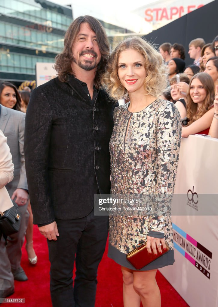 Musician <a gi-track='captionPersonalityLinkClicked' href=/galleries/search?phrase=Dave+Grohl&family=editorial&specificpeople=202539 ng-click='$event.stopPropagation()'>Dave Grohl</a> and <a gi-track='captionPersonalityLinkClicked' href=/galleries/search?phrase=Jordyn+Blum&family=editorial&specificpeople=828157 ng-click='$event.stopPropagation()'>Jordyn Blum</a> attend the 2013 American Music Awards at Nokia Theatre L.A. Live on November 24, 2013 in Los Angeles, California.