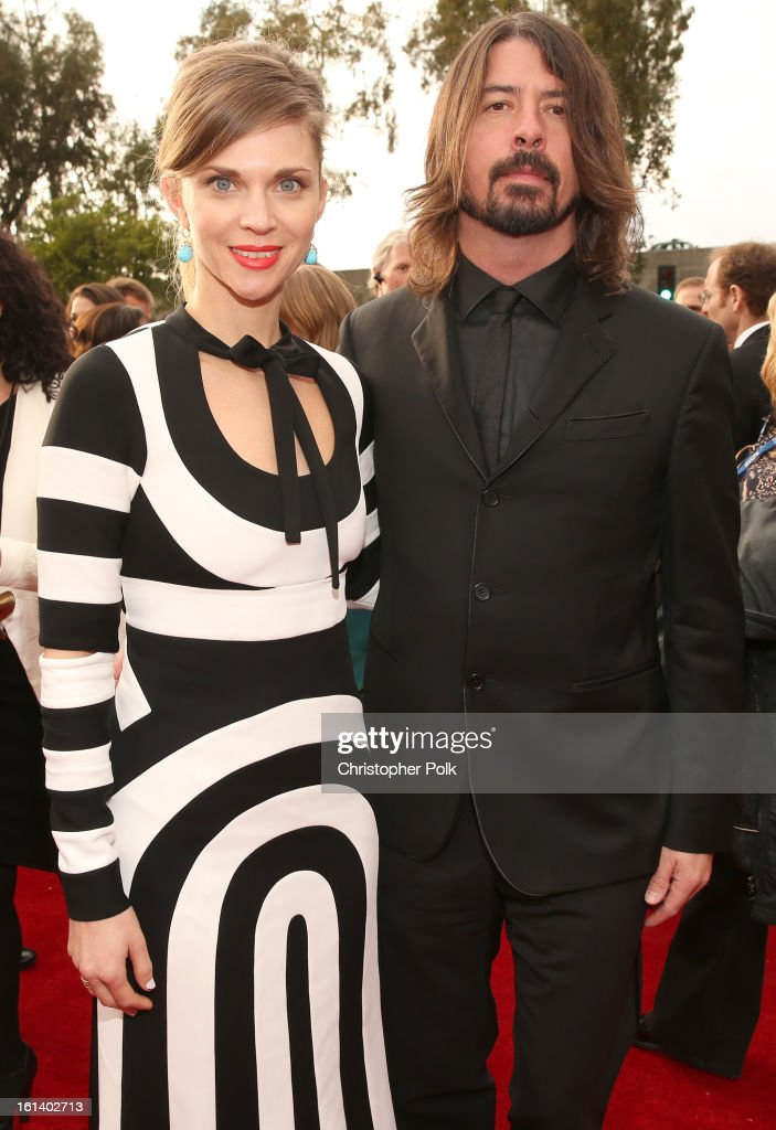 Musician Dave Grohl (R) and Jordyn Blum attend the 55th Annual GRAMMY Awards at STAPLES Center on February 10, 2013 in Los Angeles, California.