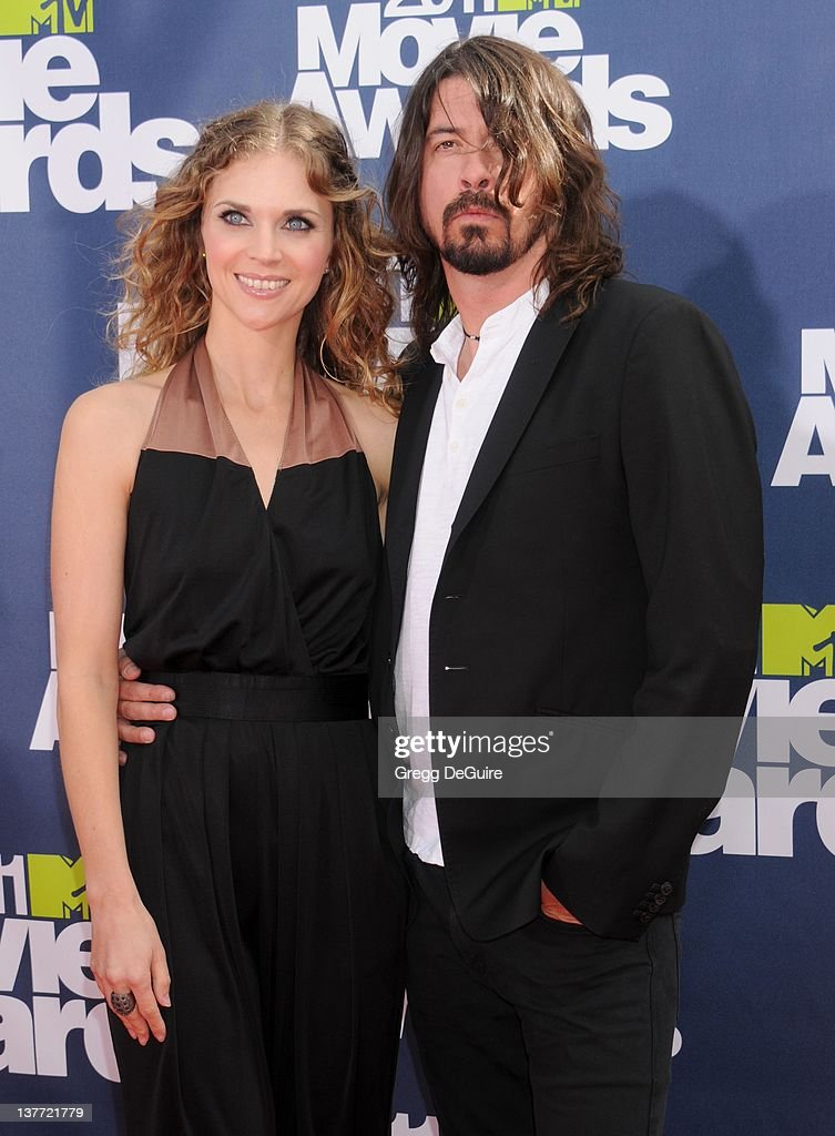 Musician <a gi-track='captionPersonalityLinkClicked' href=/galleries/search?phrase=Dave+Grohl&family=editorial&specificpeople=202539 ng-click='$event.stopPropagation()'>Dave Grohl</a> and Jordyn Blum Grohl arrive at the 2011 MTV Movie Awards at the Gibson Amphitheatre on June 5, 2011 in Universal City, California.