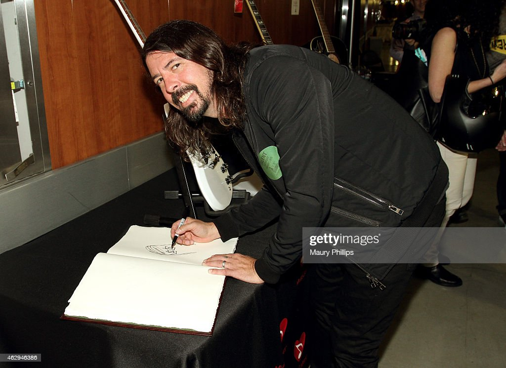 Musician <a gi-track='captionPersonalityLinkClicked' href=/galleries/search?phrase=Dave+Grohl&family=editorial&specificpeople=202539 ng-click='$event.stopPropagation()'>Dave Grohl</a> attends GRAMMY Charities Signings during The 57th Annual GRAMMY Awards at the Staples Center on February 7, 2015 in Los Angeles, California.