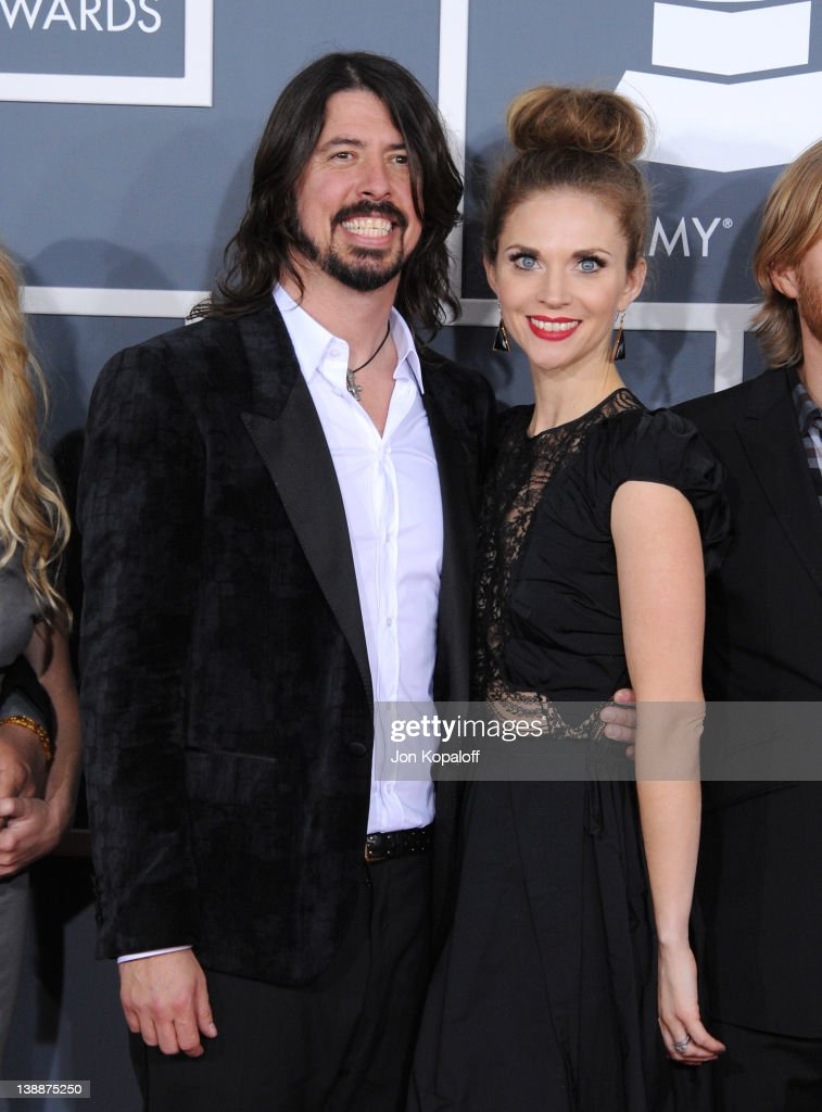 Musician Dave Grohl of Foo Fighters and wife Jordyn Blum arrive at 54th Annual GRAMMY Awards held the at Staples Center on February 12, 2012 in Los Angeles, California.