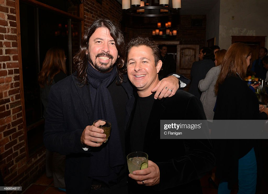 Musician <a gi-track='captionPersonalityLinkClicked' href=/galleries/search?phrase=Dave+Grohl&family=editorial&specificpeople=202539 ng-click='$event.stopPropagation()'>Dave Grohl</a> of The Foo Fighters and friend Ross Saly attend The Hollywood Reporter After Party at the Napa Valley Film Festival Celebrity Tribute on November 15, 2013 in Napa, California.