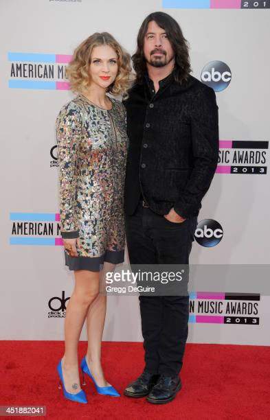 Musician Dave Grohl of the Foo Fighters and wife Jordyn Blum arrive at the 2013 American Music Awards at Nokia Theatre LA Live on November 24 2013 in...