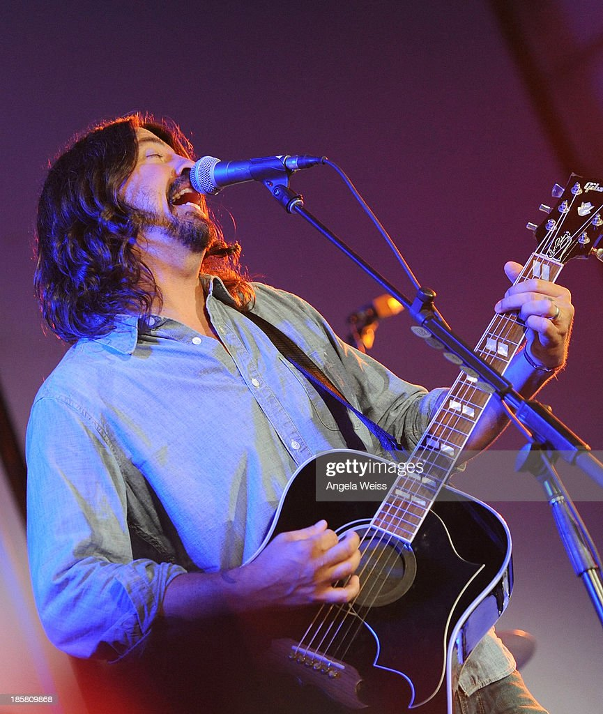 Musician <a gi-track='captionPersonalityLinkClicked' href=/galleries/search?phrase=Dave+Grohl&family=editorial&specificpeople=202539 ng-click='$event.stopPropagation()'>Dave Grohl</a> performs at Autism Speaks' 3rd Annual 'Blue Jean Ball' presented by The GUESS Foundation at Boulevard 3 on October 24, 2013 in Hollywood, California.