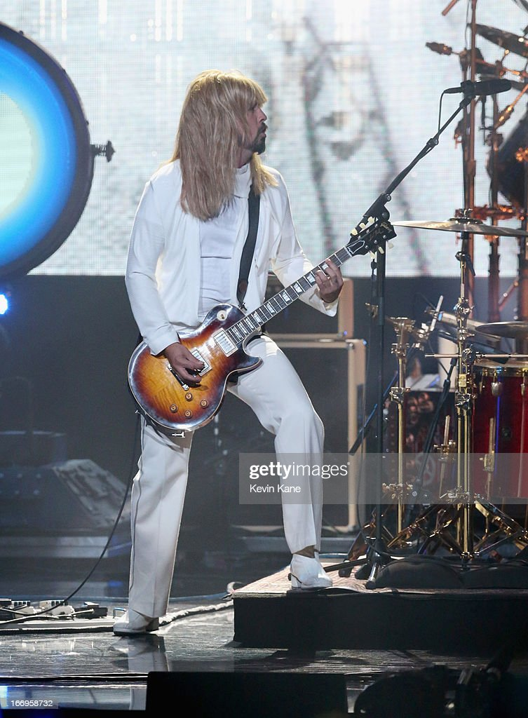 Musician <a gi-track='captionPersonalityLinkClicked' href=/galleries/search?phrase=Dave+Grohl&family=editorial&specificpeople=202539 ng-click='$event.stopPropagation()'>Dave Grohl</a> performs onstage during the 28th Annual Rock and Roll Hall of Fame Induction Ceremony at Nokia Theatre L.A. Live on April 18, 2013 in Los Angeles, California.