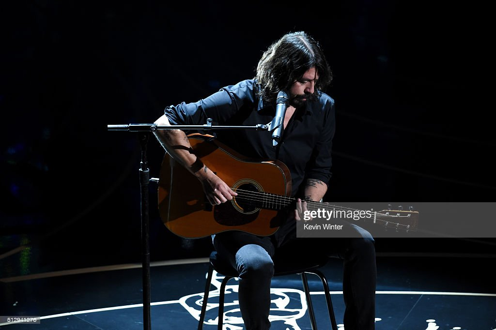 Musician <a gi-track='captionPersonalityLinkClicked' href=/galleries/search?phrase=Dave+Grohl&family=editorial&specificpeople=202539 ng-click='$event.stopPropagation()'>Dave Grohl</a> performs onstage during the 88th Annual Academy Awards at the Dolby Theatre on February 28, 2016 in Hollywood, California.