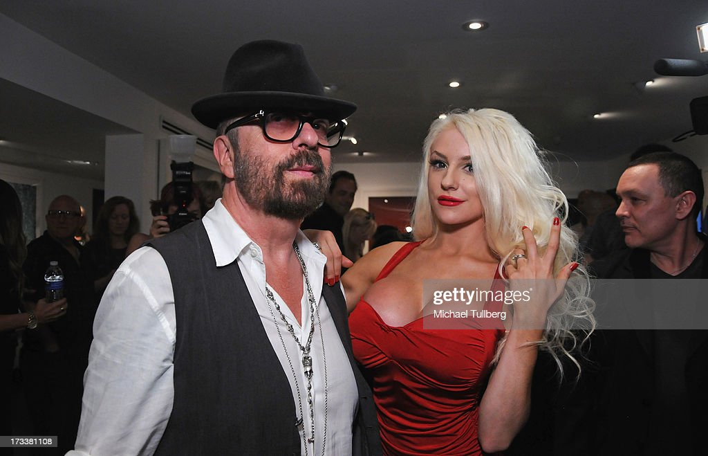 Musician Dave Stewart and actress <a gi-track='captionPersonalityLinkClicked' href=/galleries/search?phrase=Courtney+Stodden&family=editorial&specificpeople=8603458 ng-click='$event.stopPropagation()'>Courtney Stodden</a> attend the opening of Stewart's photography exhibition 'Dave Stewart: Jumpin' Jack Flash & The Suicide Blonde' at Morrison Hotel Gallery on July 12, 2013 in West Hollywood, California.