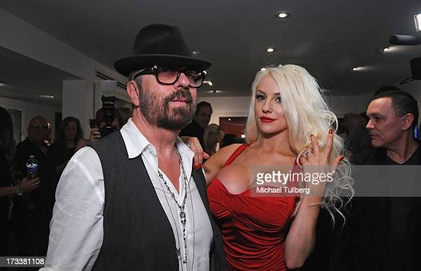 Musician Dave Stewart and actress Courtney Stodden attend the opening of Stewart's photography exhibition 'Dave Stewart Jumpin' Jack Flash The...