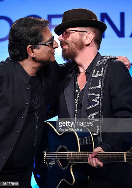Musician Dave Stewart embraces Deepak Chopra's during Oceana's 2009 Partners Award Gala on November 20 2009 in Los Angeles California