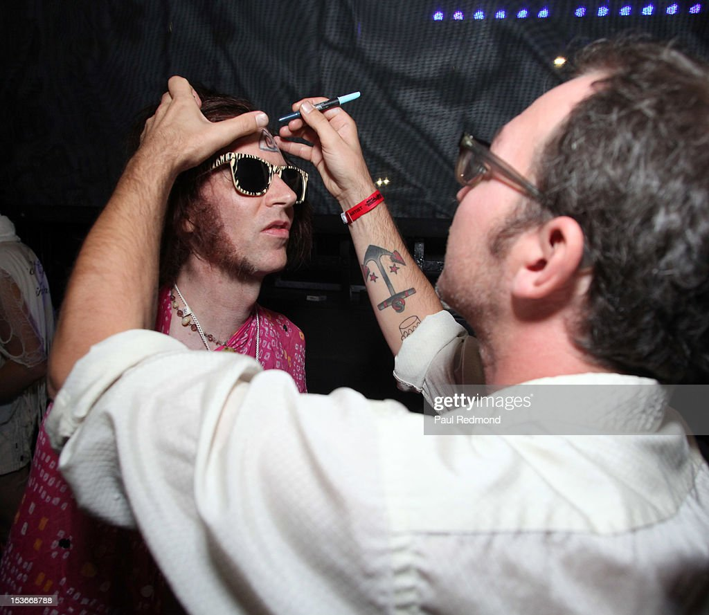 Musician Davey Pierce (L) of the band of Montreal backstage at the 3rd Annual Filter Magazine Culture Collide 2012 Festival - Day 4 on October 7, 2012 in Los Angeles, California.