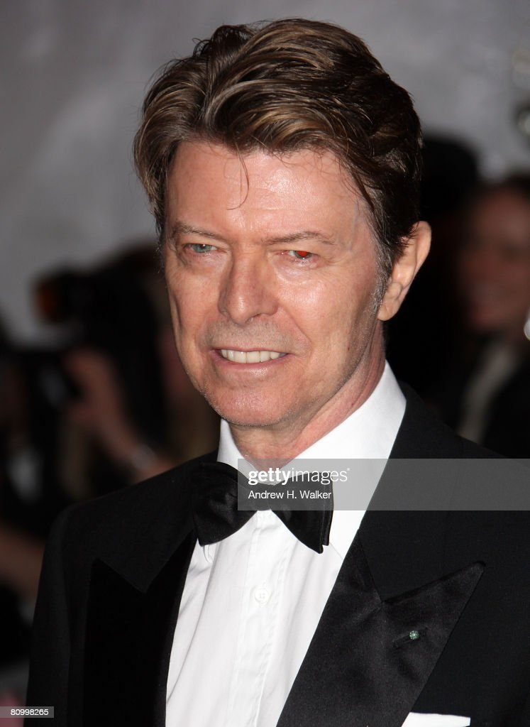 Musician David Bowie arrives to the Metropolitan Museum of Art Costume Institute Gala Superheroes Fashion and Fantasy held at the Metropolitan Museum...