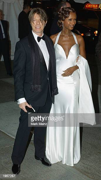 Musician David Bowie arrives with his wife model Iman for 'Goddess Costume Institute Benefit Gala' at the Metropolitan Museum of Art Costume April 28...