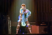 Musician David Bowie performs onstage during his 'Ziggy Stardust' era in 1973 in Los Angeles California