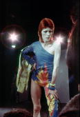 Musician David Bowie performs onstage during his 'Ziggy Stardust' era in 1973