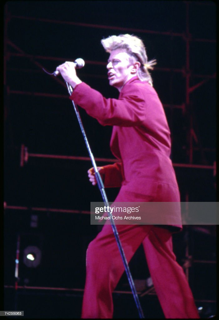 Musician <a gi-track='captionPersonalityLinkClicked' href=/galleries/search?phrase=David+Bowie&family=editorial&specificpeople=171314 ng-click='$event.stopPropagation()'>David Bowie</a> performs onstage with a vintage telephone wearing a red suit and sporting a millet hair cut in circa 1985.