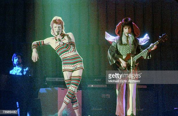 Musician David Bowie performs onstage with bass player Trevor Bolder during his 'Ziggy Stardust' era in 1973 in Los Angeles California