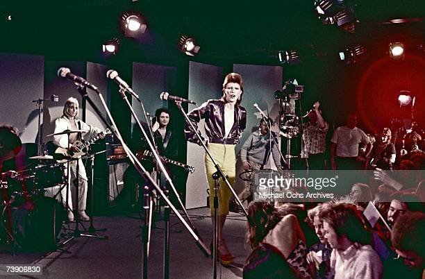 Musician David Bowie performs with his band including Mick Ronson on guitar on the Midnight Special TV show in 1973