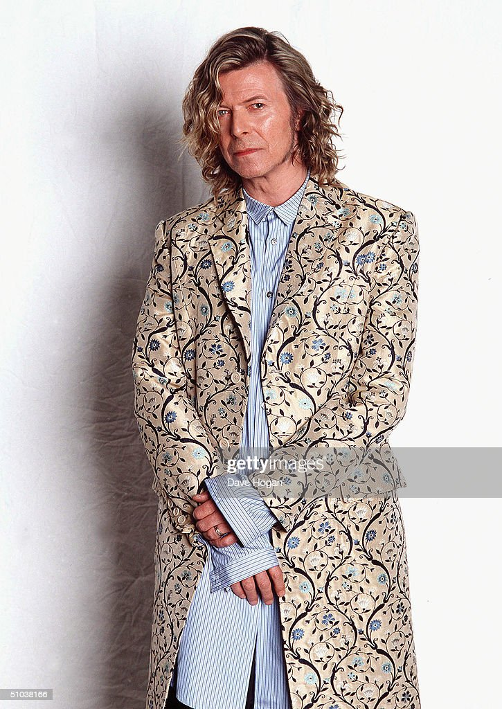Musician <a gi-track='captionPersonalityLinkClicked' href=/galleries/search?phrase=David+Bowie&family=editorial&specificpeople=171314 ng-click='$event.stopPropagation()'>David Bowie</a> poses backstage at the Glastonbury festival, in a coat designed by Alexander McQueen, at Worthy Farm, Pilton on June 25, 2000 in Somerset, England. Bowie was admitted to hospital yesterday for emergency heart surgery.
