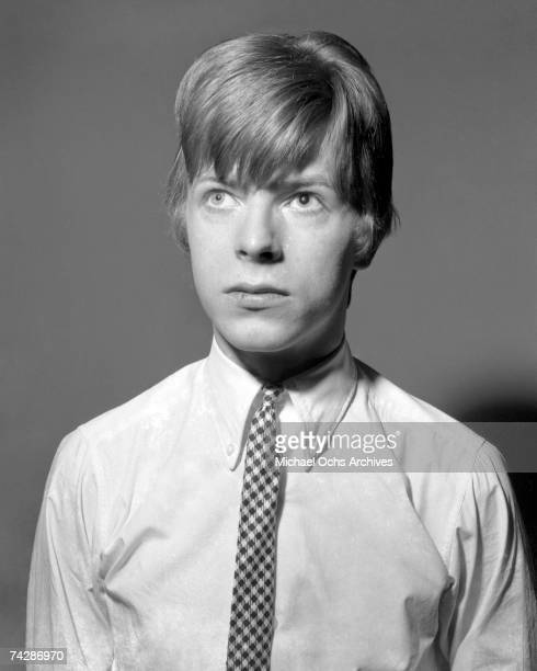 Musician David Bowie poses for a portrait session in 1966 in London England