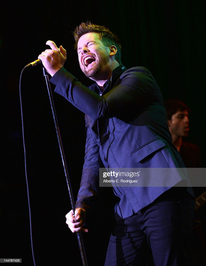 Musician <a gi-track='captionPersonalityLinkClicked' href=/galleries/search?phrase=David+Cook+-+Rock+Singer&family=editorial&specificpeople=1320413 ng-click='$event.stopPropagation()'>David Cook</a> performs onstage during the 19th Annual Race To Erase MS held at the Hyatt Regency Century Plaza on May 18, 2012 in Century City, California.