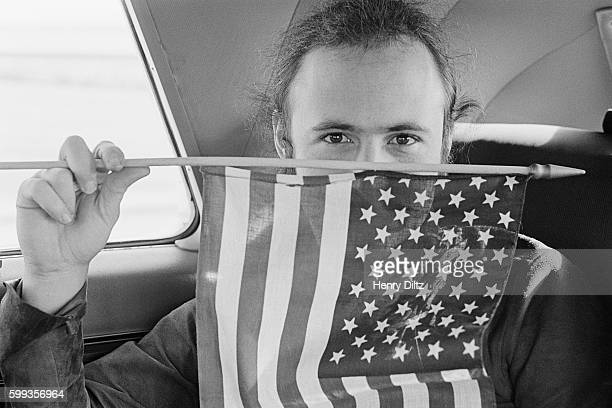 Musician David Crosby holds an American flag in front of his face He and the rest of Crosby Stills Nash and Joni Mitchell are traveling to Big Bear