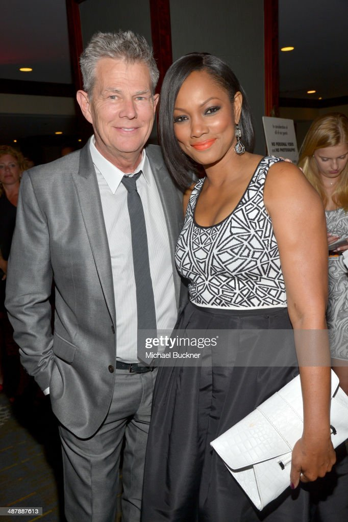 Musician David Foster and Actress Garcelle Beauvais attend the 21st annual Race to Erase MS at the Hyatt Regency Century Plaza on May 2 2014 in...