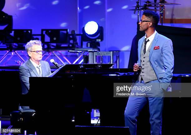 Musician David Foster and singer Eric Benet perform onstage during the 23rd Annual Race To Erase MS Gala at The Beverly Hilton Hotel on April 15 2016...