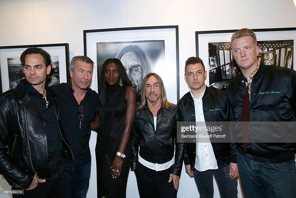 Musician Dean Fertita, photographer Andreas Neumann, his wife model Khadija Neumann, singer Iggy Pop, photographer Matt Helders and musician Josh Homme attend Iggy Pop 'Post Depression' Art Pictures Exhibition at French Paper Gallery on May 14, 2016 in Paris, France.