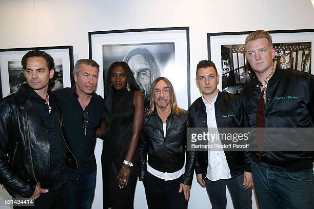 Musician Dean Fertita photographer Andreas Neumann his wife model Khadija Neumann singer Iggy Pop photographer Matt Helders and musician Josh Homme...