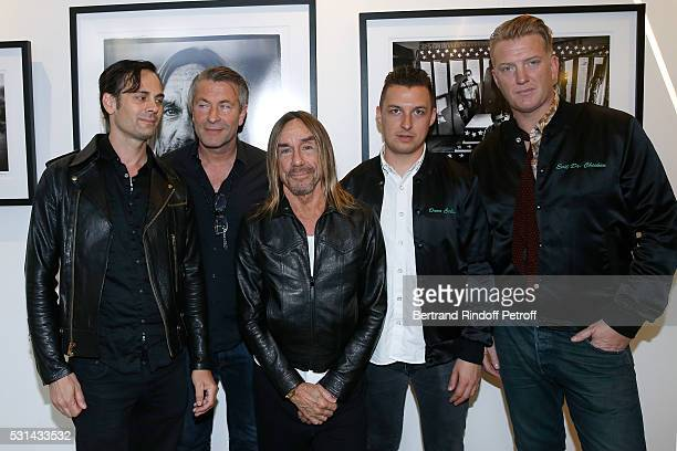 Musician Dean Fertita photographer Andreas Neumann Singer Iggy Pop photographer Matt Helders and musician Josh Homme attend Iggy Pop 'Post...