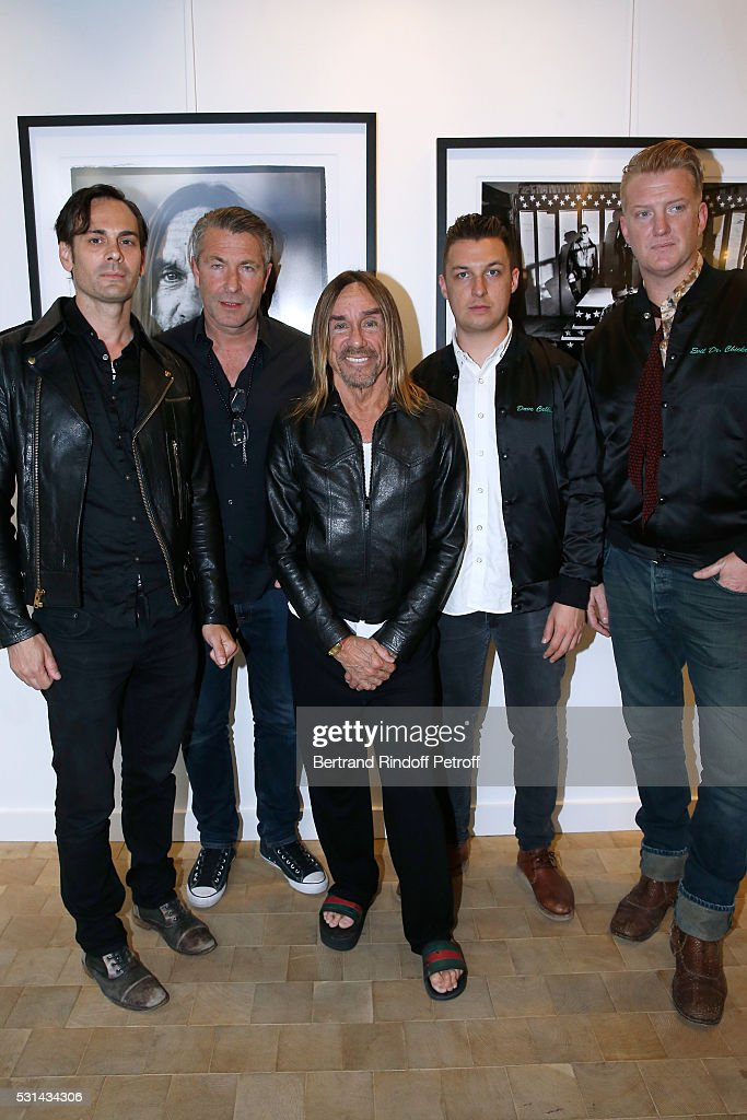 Musician Dean Fertita, photographer Andreas Neumann, Singer Iggy Pop, photographer Matt Helders and musician Josh Homme attend Iggy Pop 'Post Depression' Art Pictures Exhibition at French Paper Gallery on May 14, 2016 in Paris, France.