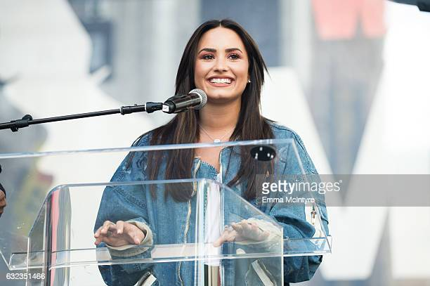 Musician Demi Lovato speaks onstage at the women's march in Los Angeles on January 21 2017 in Los Angeles California