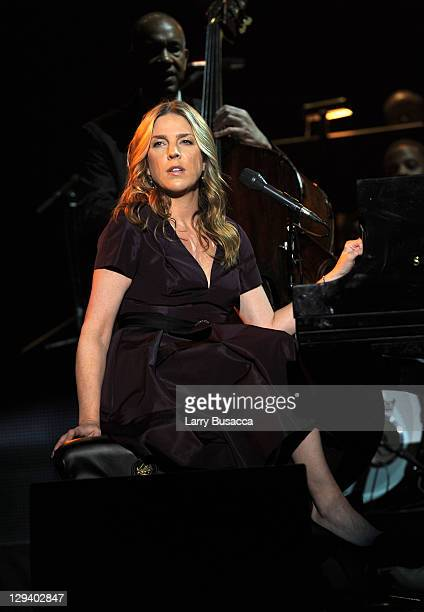 Musician Diana Krall performs onstage at 2011 MusiCares Person of the Year Tribute to Barbra Streisand at Los Angeles Convention Center on February...