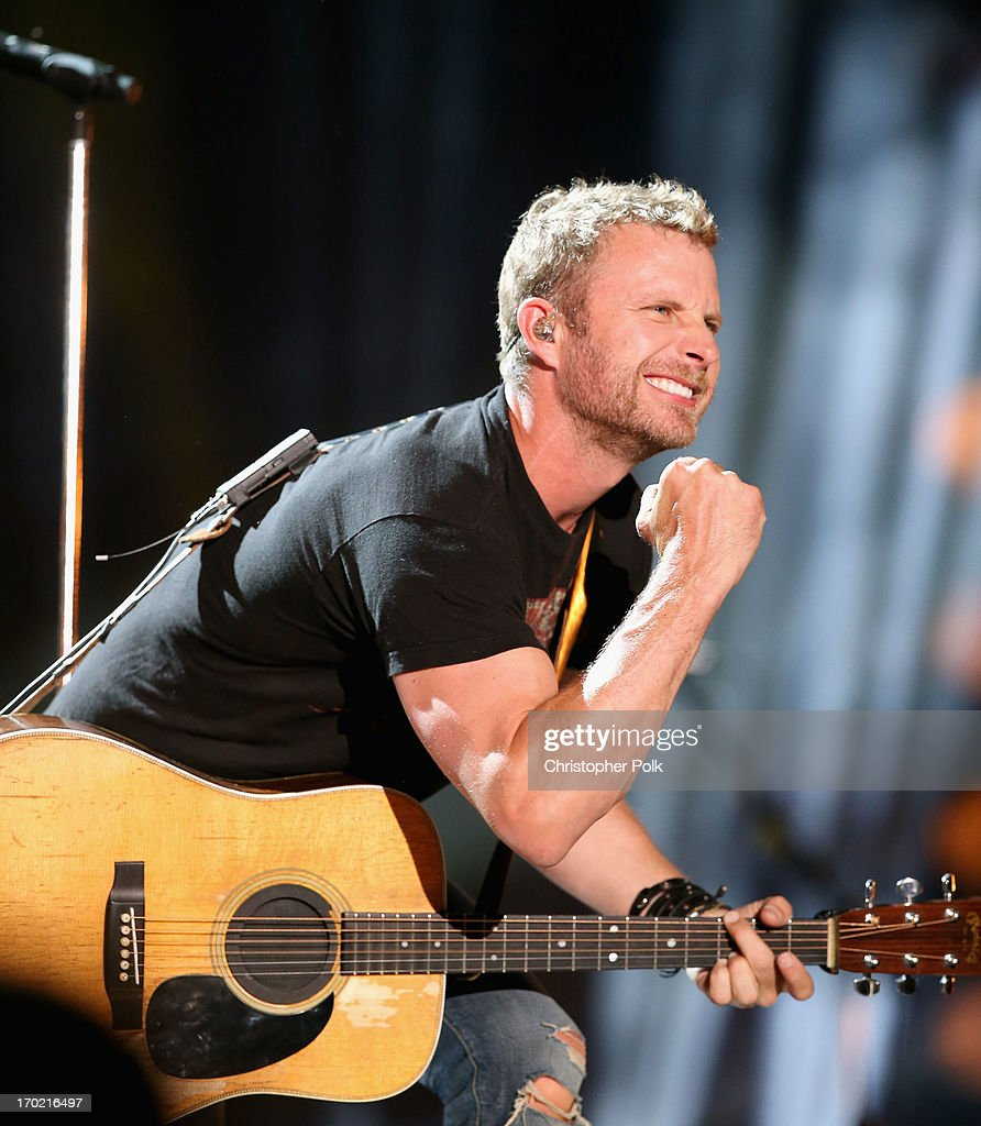 Musician <a gi-track='captionPersonalityLinkClicked' href=/galleries/search?phrase=Dierks+Bentley&family=editorial&specificpeople=243007 ng-click='$event.stopPropagation()'>Dierks Bentley</a> performs during the 2013 CMA Music Festival on June 8, 2013 at LP Field in Nashville, Tennessee.