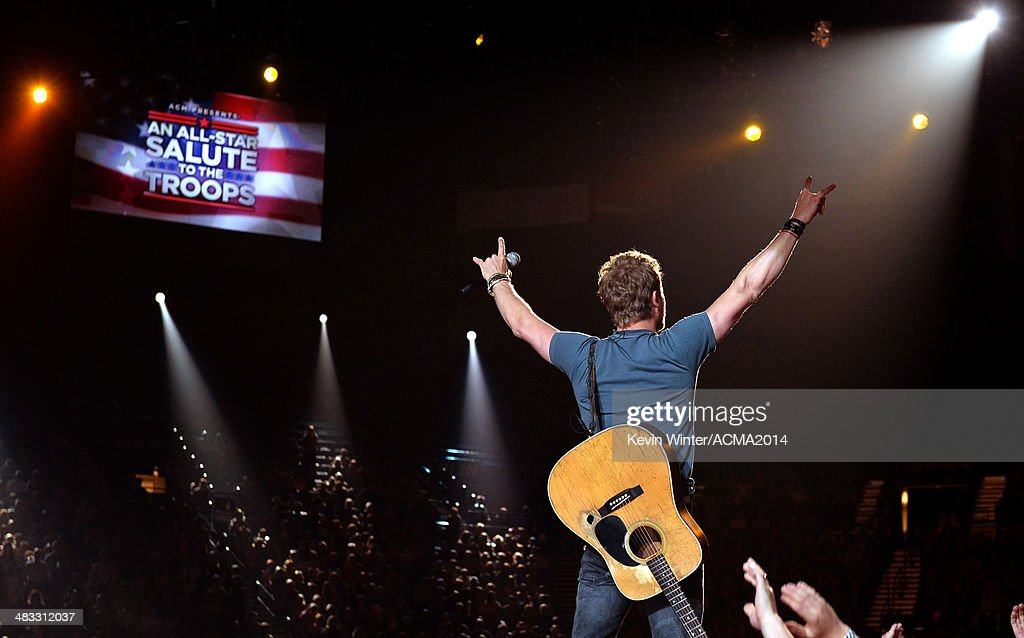Musician <a gi-track='captionPersonalityLinkClicked' href=/galleries/search?phrase=Dierks+Bentley&family=editorial&specificpeople=243007 ng-click='$event.stopPropagation()'>Dierks Bentley</a> performs onstage during ACM Presents: An All-Star Salute To The Troops at the MGM Grand Garden Arena on April 7, 2014 in Las Vegas, Nevada.