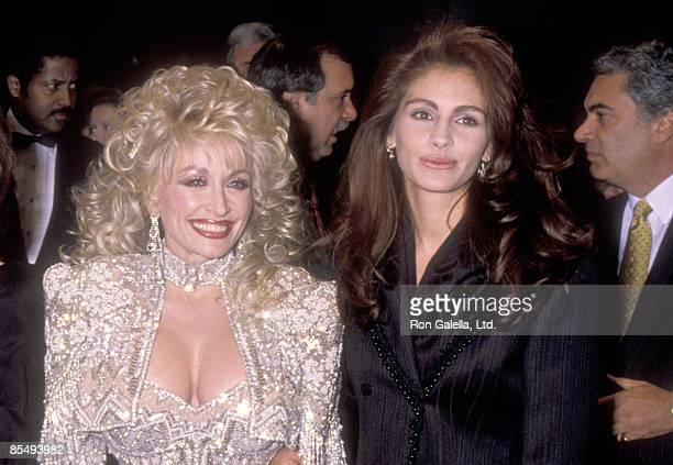 Musician Dolly Parton and Actress Julia Roberts attend the 'Steel Magnolias' New York City Premiere on November 5 1989 at Ziegfeld Theater in New...