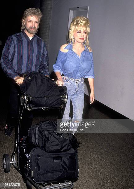 Musician Dolly Parton and her hairdress on August 24 1993 arriving at the Los Angeles International Airport in Los Angeles California