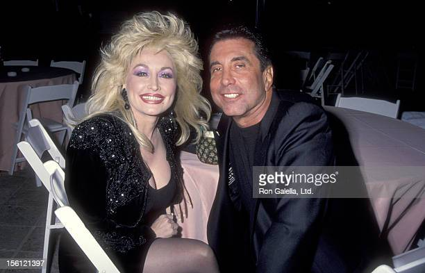 Musician Dolly Parton and Hollywood Manager/Producer Sandy Gallin attend the Party to Celebrate Kelly Klein's New Book 'Pools' on November 19 1992 at...