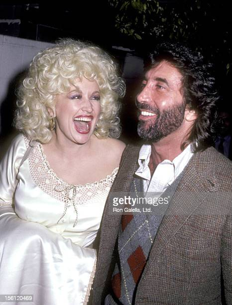 Musician Dolly Parton and Manager/Producer Sandy Gallin on March 10 1983 dining at Spago in West Hollywood California