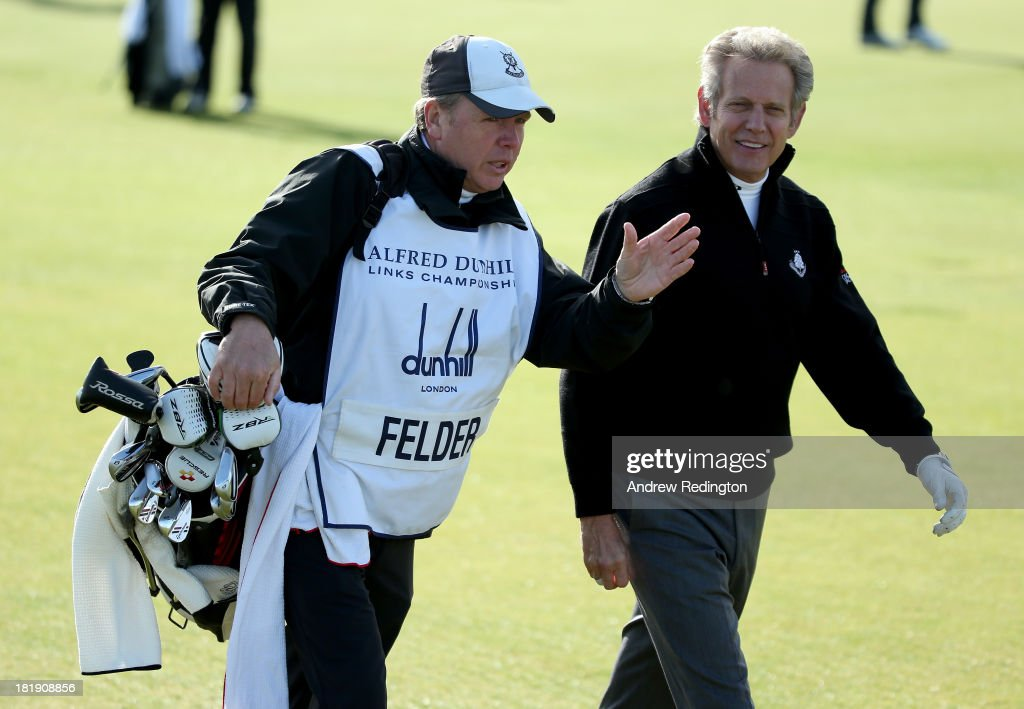 Musician Don Felder with his caddy on the second tee during the first round of the Alfred Dunhill Links Championship on The Old Course, at St Andrews on September 26, 2013 in St Andrews, Scotland.