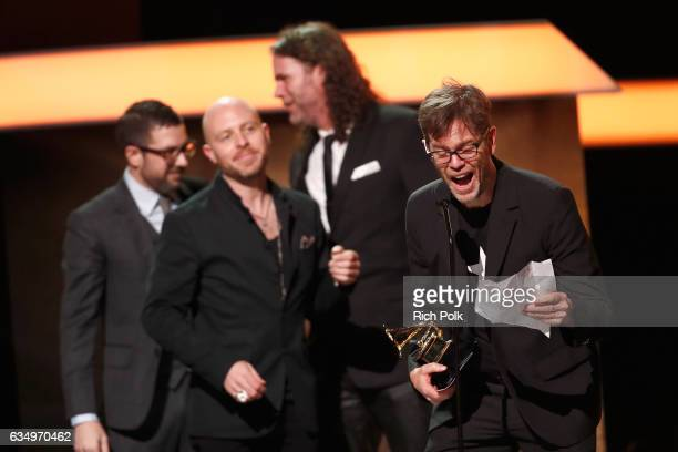 Musician Donnie McCaslin accepts the Best Rock Performance for ' Blackstar' onstage at the Premiere Ceremony during the 59th GRAMMY Awards at...