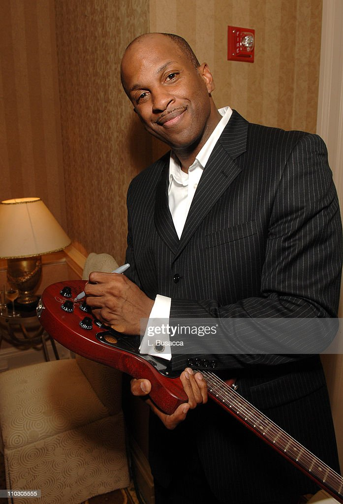 Musician Donnie McClurkin signs a guitar during the Recording Academy New York Chapter's Tribute to Bon Jovi Alicia Keys Donnie McClurkin and the...