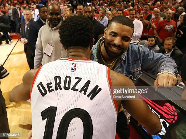 Musician Drake congratulates DeMar DeRozan of the Toronto Raptors after defeating the Indiana Pacers in Game Seven of the Eastern Conference...