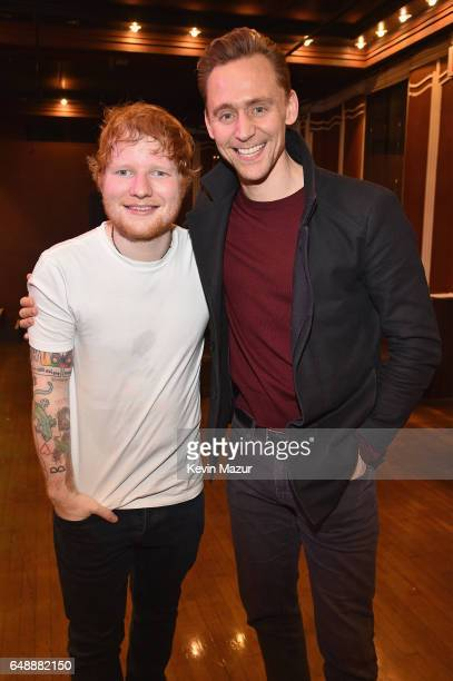 Musician Ed Sheeran and actor Tom Hiddleston pose backstage after SiriusXM's 'Secret Show' Series with Ed Sheeran at The Studio at Webster Hall on...