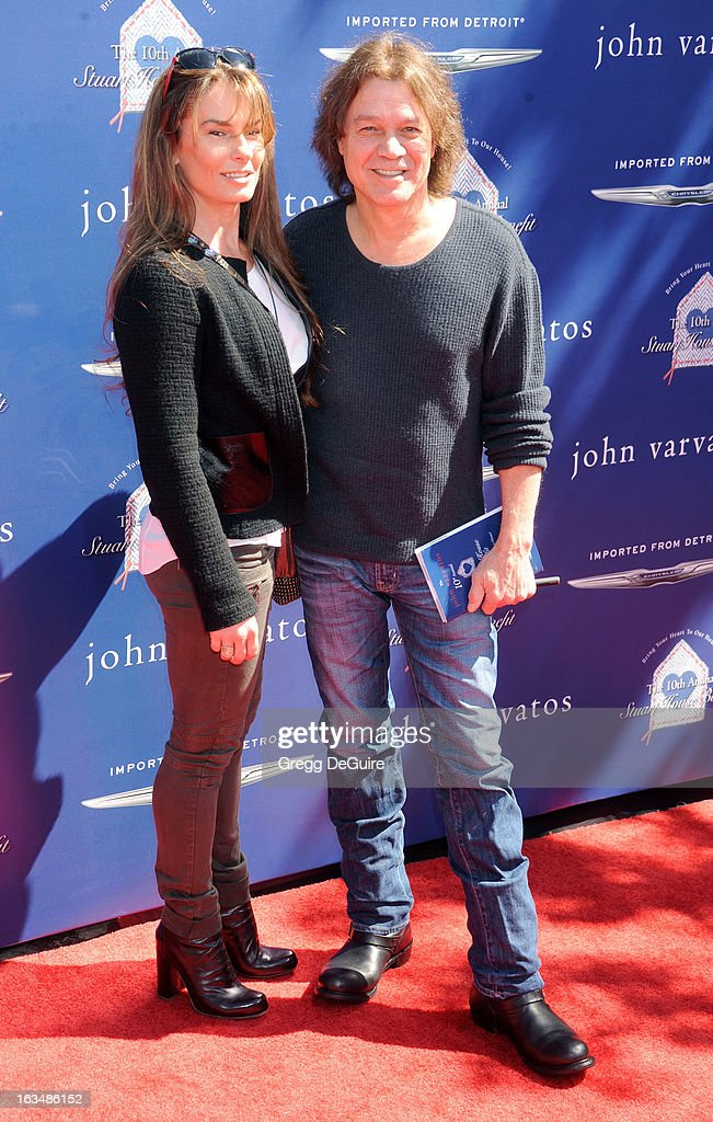 Musician Eddie Van Halen (R) and wife Janie Liszewski arrive at John Varvatos 10th Annual Stuart House Benefit at John Varvatos Los Angeles on March 10, 2013 in Los Angeles, California.