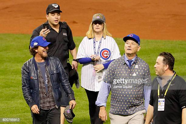 Musician Eddie Vedder comedian Bonnie Hunt and actor Bill Murray walk on the field after the Chicago Cubs defeated the Cleveland Indians 87 in Game...