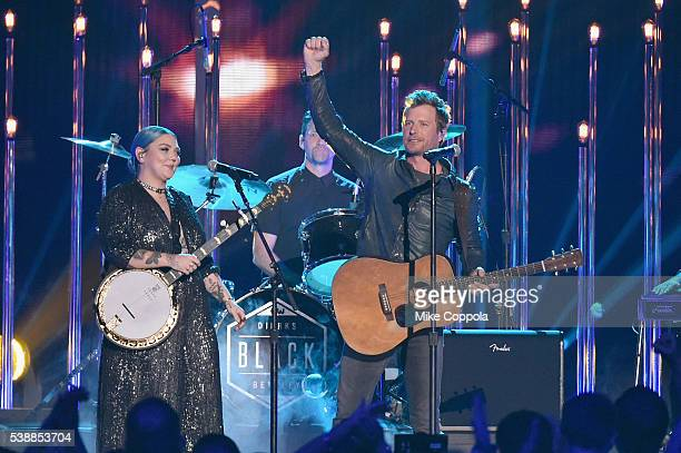 Musician Elle King and singer Dierks Bentley perform onstage during the 2016 CMT Music awards at the Bridgestone Arena on June 8 2016 in Nashville...
