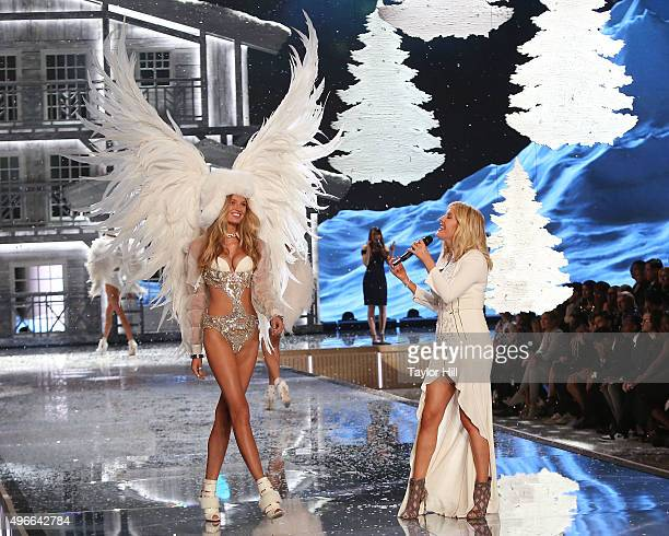 Musician Ellie Goulding performs as model Romee Strijd walks the runway during the 2015 Victoria's Secret Fashion Show at Lexington Avenue Armory on...