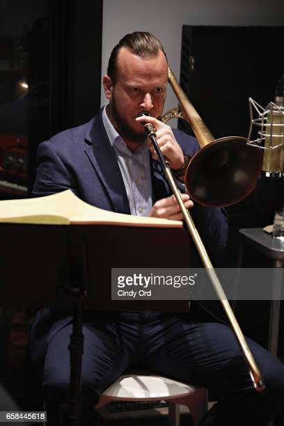 Musician Elliot Mason plays trombone as Wynton Marsalis and Jon Batiste perform the music of John Lewis at Spotify Studio for Jazz at Lincoln...