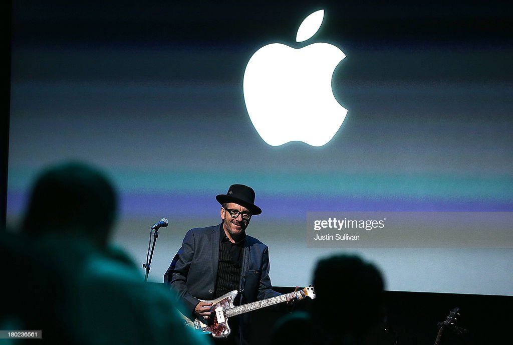 Musician Elvis Costello performs during an Apple product announcement at the Apple campus on September 10, 2013 in Cupertino, California. The company launched the new iPhone 5C model that will run iOS 7 is made from hard-coated polycarbonate and comes in various colors and the iPhone 5S that features fingerprint recognition security.
